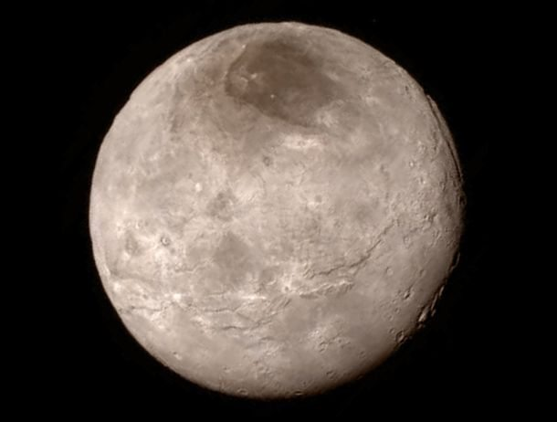 New details of Pluto's largest moon Charon are revealed in this image from New Horizons' Long Range Reconnaissance Imager (LORRI), taken late on July 13, 2015 from a distance of 289,000 miles (466,000 kilometers) in a picture released by NASA in Laurel, Maryland July 15, 2015. A U.S. spacecraft sailed past the tiny planet Pluto in the distant reaches of the solar system on Tuesday, capping a journey of 3 billion miles (4.88 billion km) that began nine and a half years ago. NASA's New Horizons spacecraft passed by the ice-and-rock planetoid and its entourage of five moons at 7:49 a.m. EDT (1149 GMT). The event culminated an initiative to survey the solar system that the space agency embarked upon more than 50 years ago. REUTERS/NASA New Horizons/Handout via Reuters TPX IMAGES OF THE DAY. THIS IMAGE HAS BEEN SUPPLIED BY A THIRD PARTY. IT IS DISTRIBUTED, EXACTLY AS RECEIVED BY REUTERS, AS A SERVICE TO CLIENTS. FOR EDITORIAL USE ONLY. NOT FOR SALE FOR MARKETING OR ADVERTISING CAMPAIGNS
