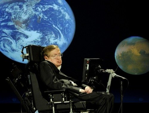 """Stephen Hawking...Dr. Stephen Hawking, a professor of mathematics at the University of Cambridge, delivers a speech entitled """"Why we should go into space"""" during a lecture that is part of a series honoring NASA's 50th Anniversary, Monday, April 21, 2008, at George Washington University's Morton Auditorium in Washington. Photo Credit: (NASA/Paul. E. Alers)"""