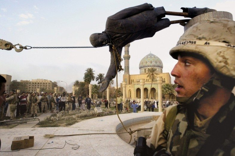 Iraqi-civilians-and-U.S.-soldiers-pull-down-a-statue-of-Saddam-Hussein-in-downtown-Baghdad-in-this-April-9-2003-file-photo.-AP-PhotoJerome-Delay-File-960x641-785x524