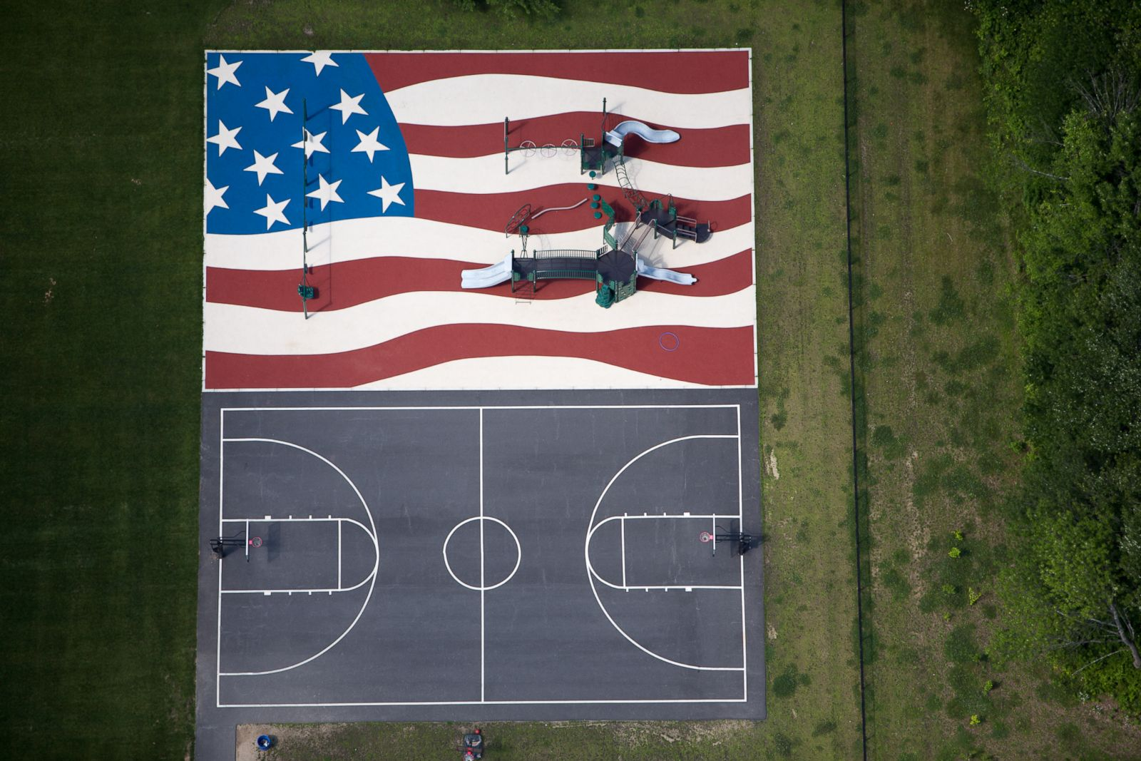An-American-flag-playground-and-a-basketball-court-in-Stow-Massachussetts